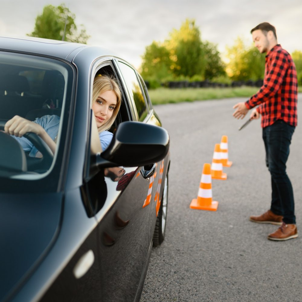 male-instructor-happy-with-driving-of-his-student.jpg